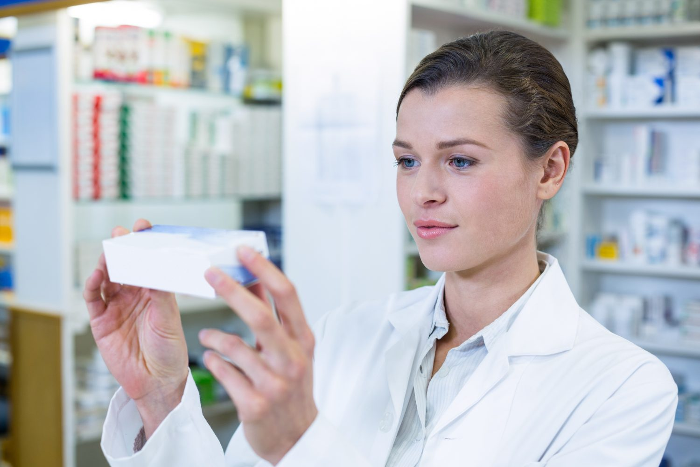 Pharmacist checking a medicine box